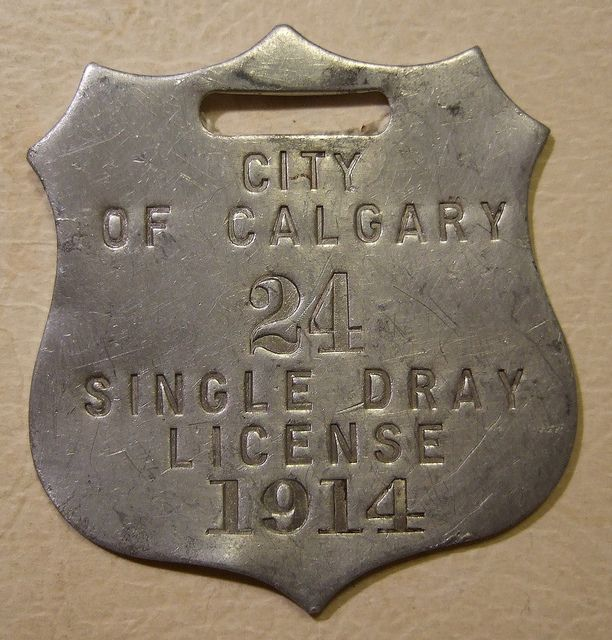 A single Dray License Plate was required for a one horse and carriage in the city of Calgary Alberta, Canada. circa 1914 ~ Photo by...Jerry Woody©