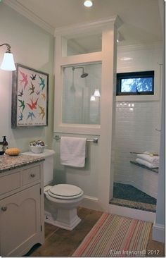 Love the open shower, that only half the wall is glass and the top is open.