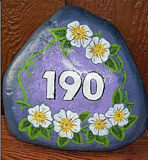 Painted Rock Address Marker...pretty and useful decoration for your yard. I painted my house numbers with glow-in-the-dark paint!