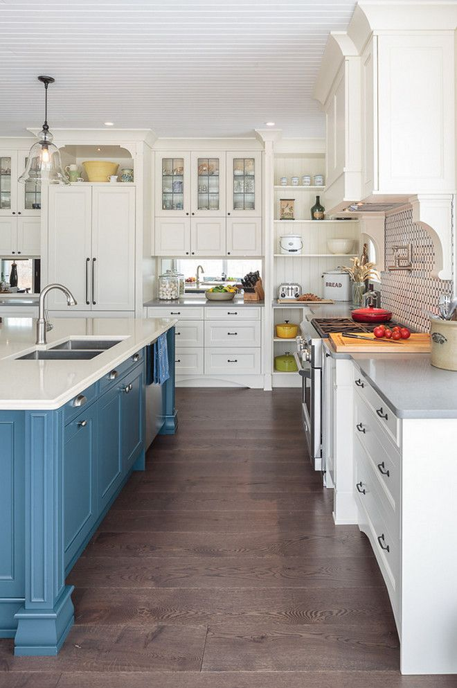 A Solid Walnut Countertop Creates A Designated Seating Area On The Blue  Painted Island. The. Kitchen Cabinet ...