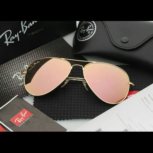 Ray-Ban Gold with Pink Trim Aviator Sunglasses These Ray-Ban Sunglasses are flawless! They are like new, excellent used condition. They are gold with a light-pink, mirror lens that makes them even more fun to wear! What girl could say no??!?? ;) Ray-Ban Accessories Glasses