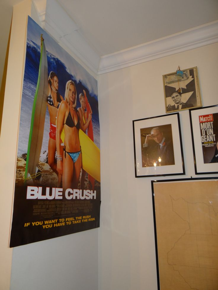 """On the left side of the command centre, is a poster for the 2002 kick-arse surfer movie """"Blue Crush"""". http://en.wikipedia.org/wiki/Blue_Crush"""