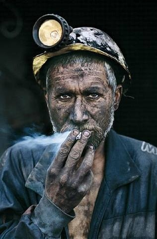 Miner smoking, Pul-I-Kumri, Afghanistan, 2002 By: Steve McCurry