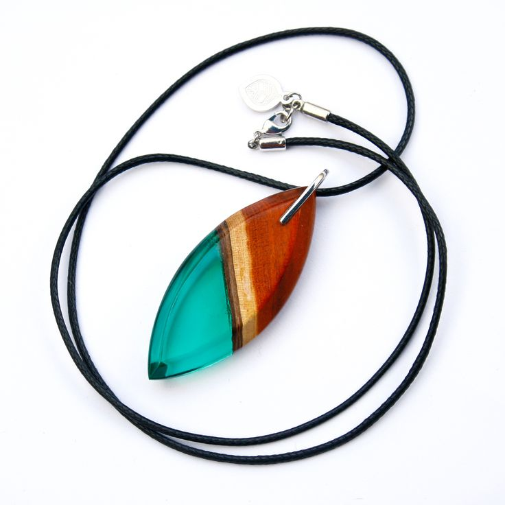 our sustainable redwood and emerald green resin pendant on black waxed cord