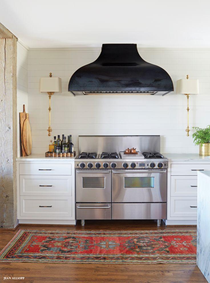 A dark range hood in an otherwise light kitchen. Plus, a vintage runner rug.