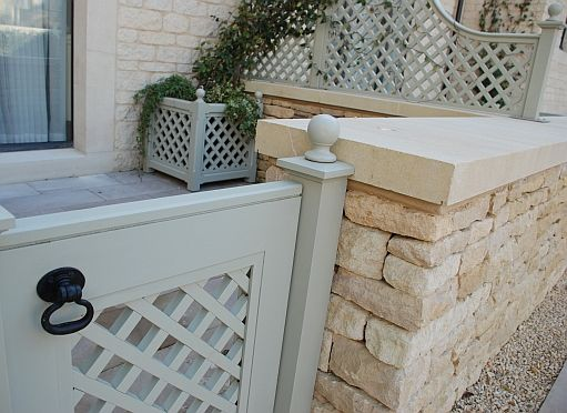 soft French grey garden trellis fencing and gate, so pretty against the creamy pale stone
