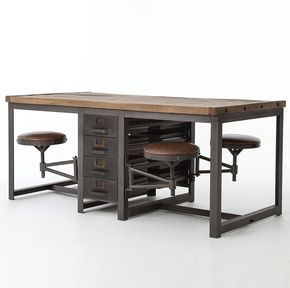 Industrial style and modern functionality are reflected in our Rupert Industrial Architect Work Table Desk. This work table features eco-friendly construction, architectural hand forged iron frame and four swinging leather seats for charming eclectic home office decor. With rustic black finish, reclaimed pine wood table top and adjustable leather chairs, this work desk will become the focal point in your…
