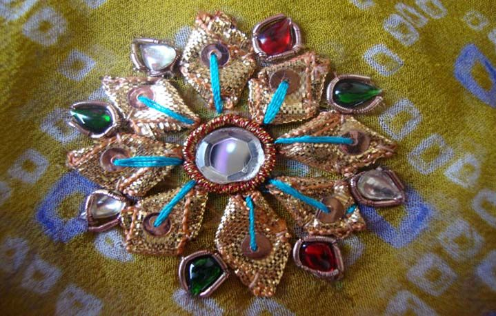 Gota work (appliqued gold ribbon pieces)