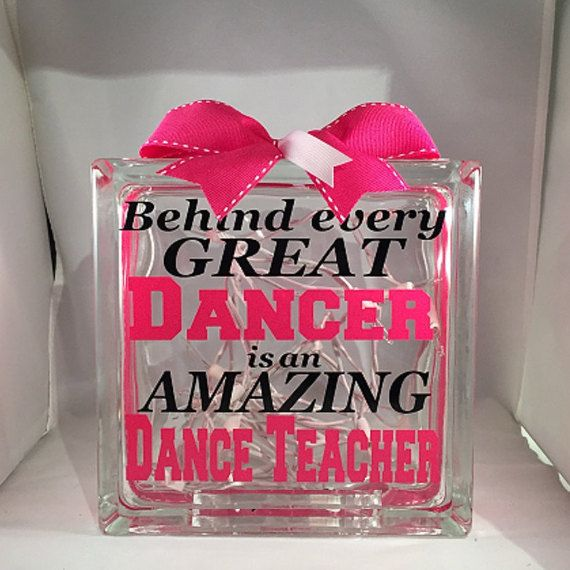 This custom glass block is a great unique gift for any amazing dance teacher. Customized in the dance team/dance studio colors and the year and dancers names on the back this gift is a great keepsake to give to a teacher/coach to say Thank You. The design is cut from large sheets of premium grade color vinyl and is topped off with a hand-tied coordinating bow in the team colors. Inside you will find a strand of 20 clear lights with a white cord with a 3ft lead.  Please Note: This bl...
