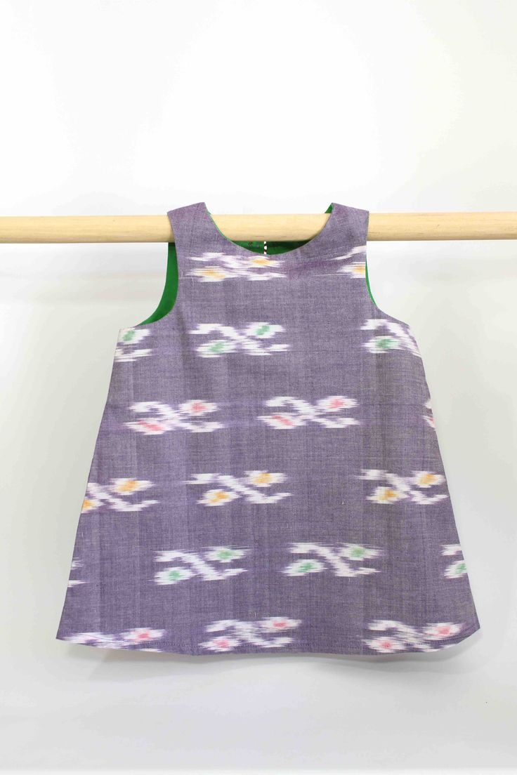Light Purple Blur Dress with Green Lining: This super cute summer dress not only looks great on kids but is also comfortable to wear and easy to clean, making it perfect for all occasions and still allowing a kid to be a kid.