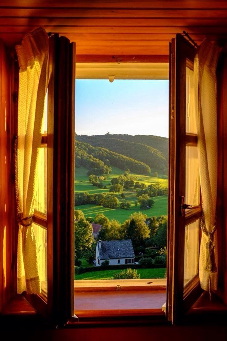 view from a window of the mountains