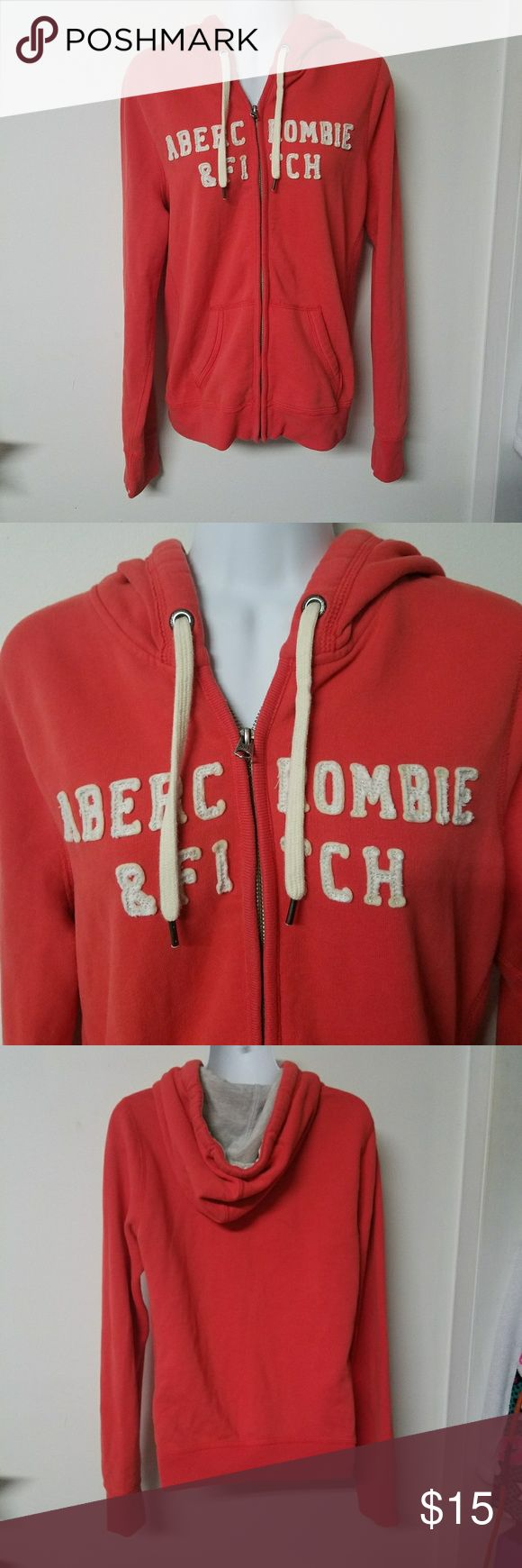 Abercrombie and Fitch coral hoodie juniors large Up for sale is an Abercrombie and Fitch coral pink hoodie. It has cream colored lettering and strings. The size is a juniors large. It is in great condition with lots of wear left!! Love their hoodies because they are so comfy and warm! Just don't wear this anymore.   Thanks for looking and ask any questions.   Open to offers!💗 Abercrombie & Fitch Sweaters