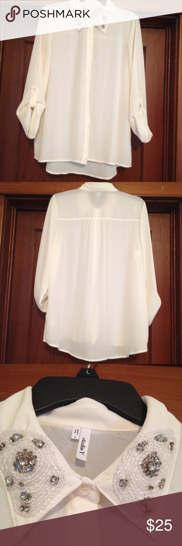 Studio Y cream long sleeved top size L Studio Y Creme long sleeved blouse . Has front bottom closure with overlay and sleeves can be raised and buttoned. Has rhinestones and beads on color. Studio Y Tops Blouses