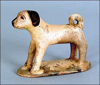 "PENNSYLVANIA REDWARE DOG, 19th c., with a cream and brown glaze, 3 1/4"" h., 4"" w."