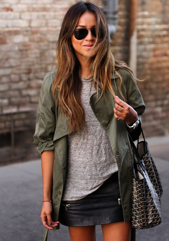 Sincerely Jules Is Wearing A Black Leather Mini Skirt From Zara, Army Green Jacket From Current/Elliott, Grey T-Shirt From Madewell, Bag From Goya And Sunglasses From RayBan