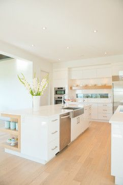 Jenny's Modern Home - love this undermount apron front stainless sink. Especially in an all white / maple space.