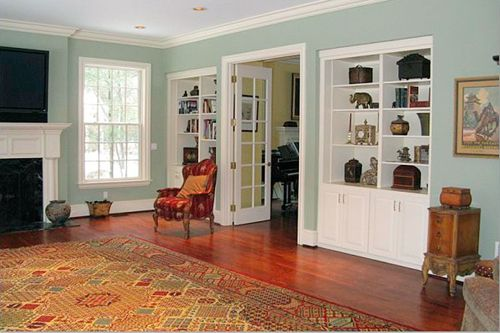 Devine Color - Devine Almond, cherry wood floors, white shelves, built in shelves, vintage furniture, colofrul rug