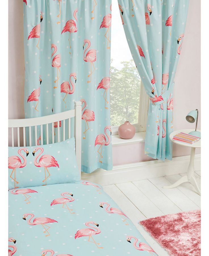 Stylish Fifi Flamingo Curtains feature flamingos on a pale turquoise blue and white polka dot themed background. Matching bedding and free UK delivery available.