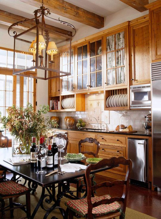 A Classical Journey: The Work of Architect Ken Tate Heart pine was used for beams in the kitchen; old cypress was used for the doors and for the kitchen cabinets. The materials give a look that's honest, hardworking, and warm.