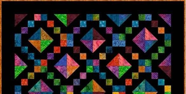 """Be Inspired by These Colorful Examples! The """"Jewel Box Quilt"""" is an old pattern that begs to be experimented with. The quilt is usually made from jewel tone fabrics against a contrasting background, often black. The vivid colors pop against the black and glow like jewels. Image courtesy of About.com. Batik fabrics are very effective …"""