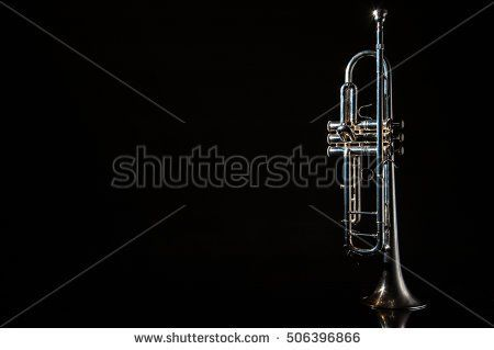 Damian Gretka. Microstock Photography. lonely musical instrument which is a trumpet on a black background / trumpet