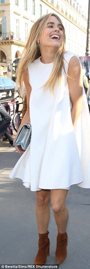 The actress showed off her toned and tanned legs in the short-hemmed dress...