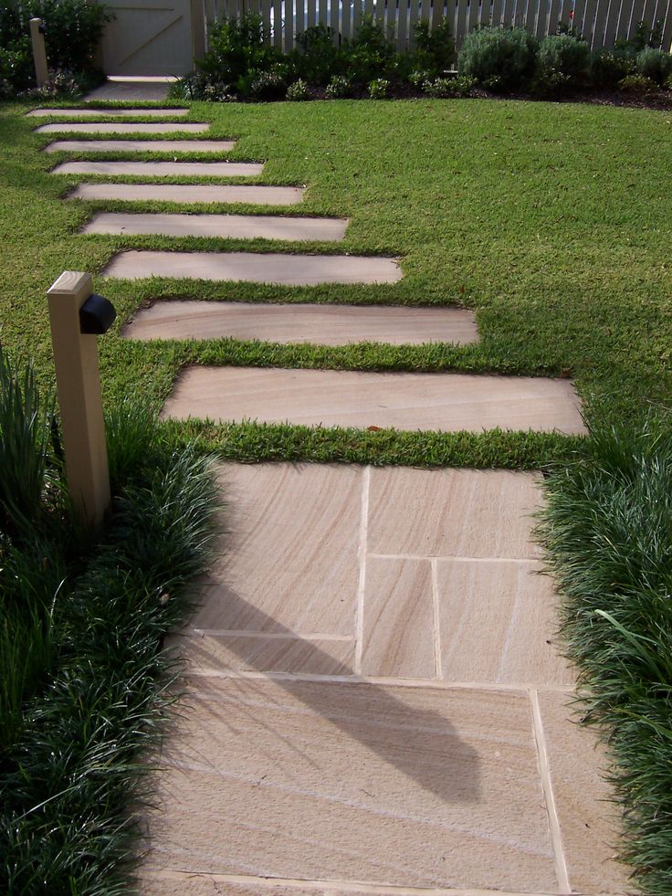 Sandstone path through lawn area. Designed and constructed by Joanne Green Landscape Design.