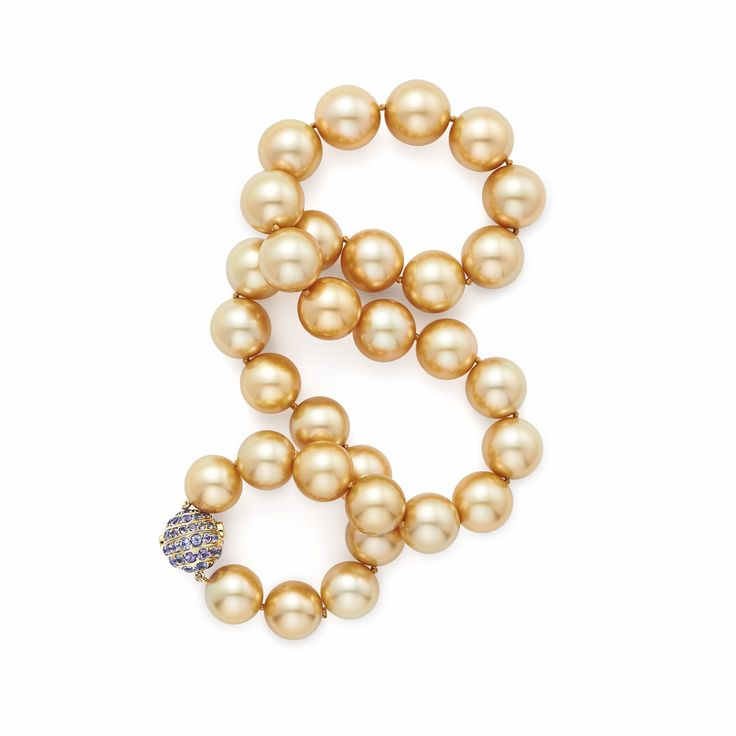 Tiffany pearl necklace from the 2015 Blue Book collection in 18ct gold featuring golden South Sea pearls and a tanzanite-set clasp