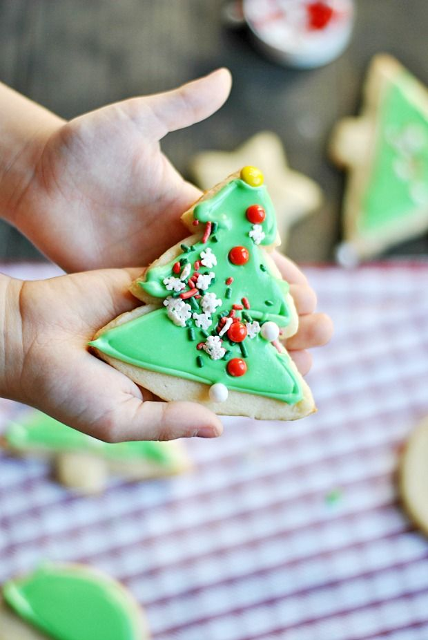 Check out this super simple trick to getting canned icing to look as beautiful as royal icing when decorating sugar cookies. Saves time and headache!