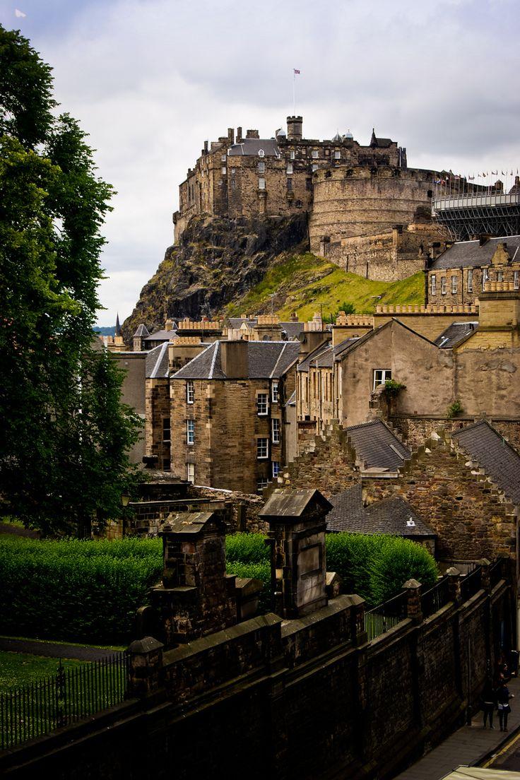 Edinburgh Castle is a fortress dominating skyline of Edinburg, Scotland atop volcanic Castle Rock - by Lee Crawford