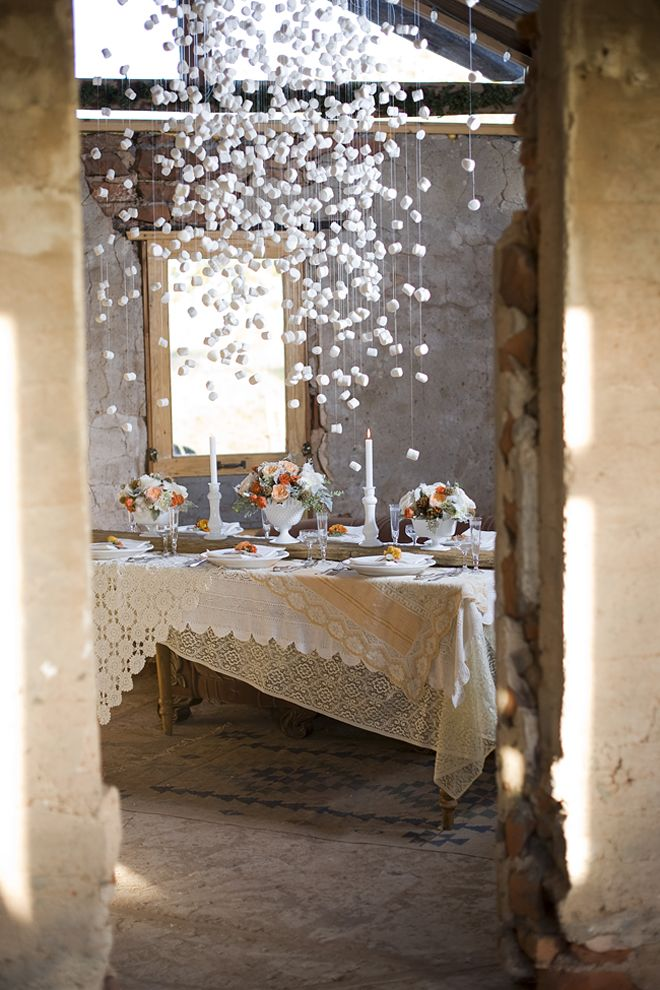 """The marshmallow """"chandelier"""" might be a tad over the top, but there are many other charming touches to be found in the pics from this wedding: layering of lace tablecloths, place settings, buffet table, flowers, etc."""