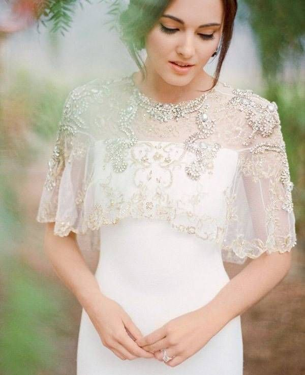 bride with lace and beaded jacket for a spring or summer wedding