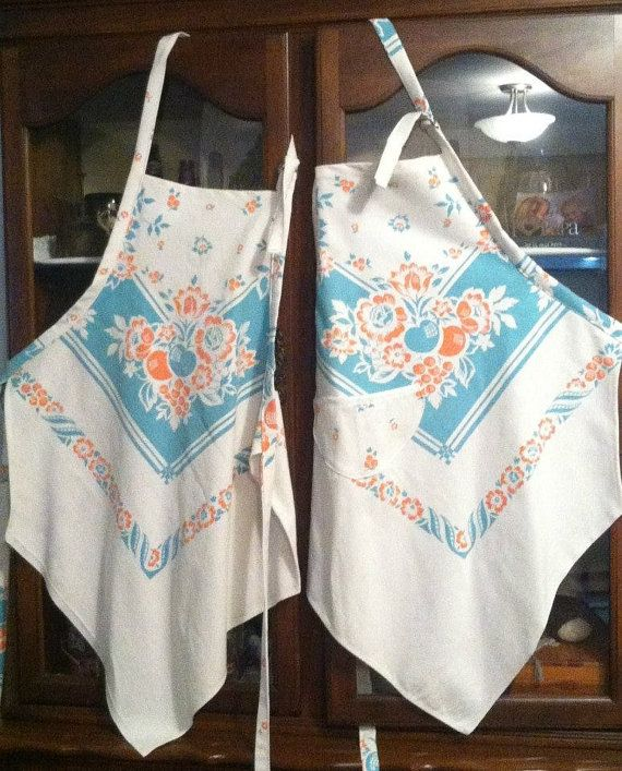 Vintage tablecloth aprons. Great idea for ones you can't get stains out of