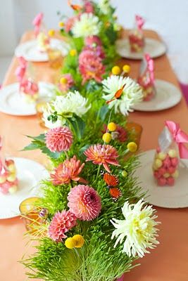 Easter table-scape. MpM: when I've used real grass for an Easter display, I plant the grass seed ~3 weeks before Easter. Planting and watering grass seed is a wonderful project to share with your grand children. :-)