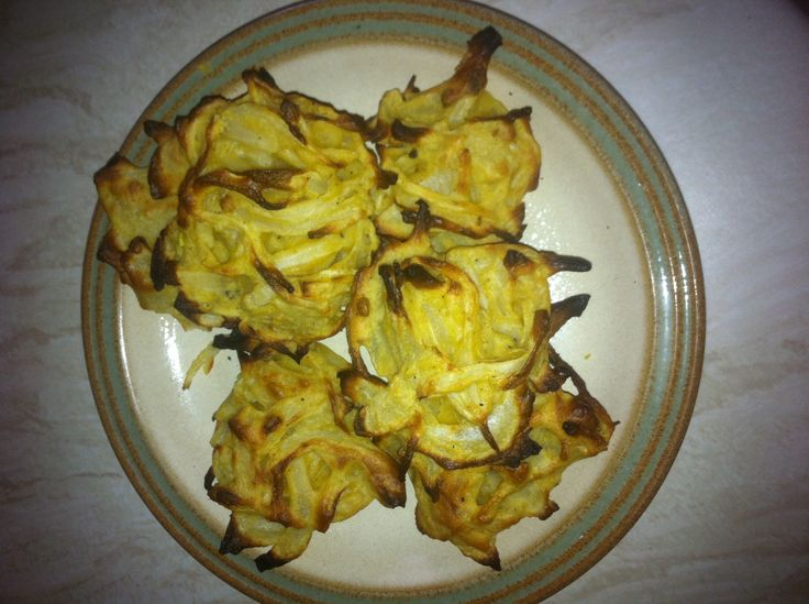 Slimming World: Onion Bhajis:  Place 200g thinly sliced onion, 60g gram flour, 1 tbsp chopped coriander, 1 tsp lemon juice, 2 tsp ground cumin,  1 tsp chopped green chilli, 1 tbsp crushed coriander seeds, 1/4 level tsp baking powder in a bowl together. Season salt and pepper, add few tbsp water to form batter and coat onion.  Leave to rest 15 mins, use fingers to combine make 12 bhajis cook 200c for 20 mins.  Spray low cal cooking spray.