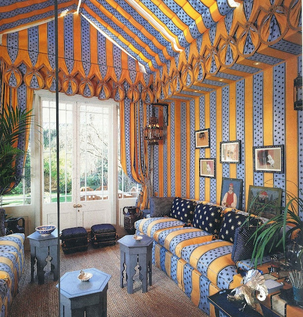 John Stefanidis: I added a conservatory to this Regency rectory. Electrically controlled roof blinds are in the same fabric as the walls and sofas. The fabric was specially designed and printed in yellow and blue stripes with stars. This room could be filled with sunlight or, with the curtains drawn, the pattern and colour of the fabric made the room glow - a perfect overflow space for parties.