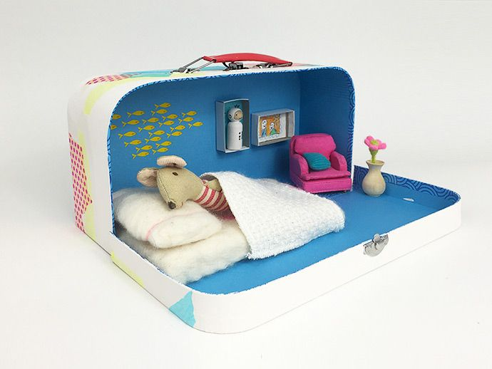 Transform an old school lunch box into a darling dollhouse that your little ones can pack up and take along on summer vacation.