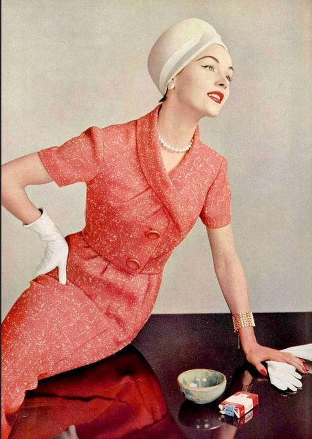 Model wearing a coral tweed suit by Pierre Balmain, 1957. Photo by Philippe Pottier.