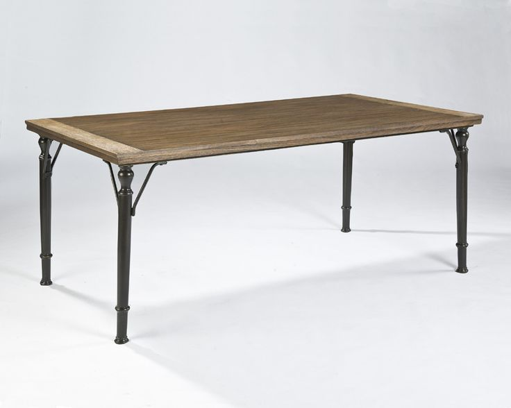 The Table Apron And Braced Leg Are Made From Tubular Metal In An Aged Brown Color
