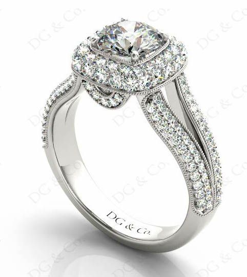 BRILLIANT CUT DIAMOND RING WITH PAVE SET BRILLIANT CUT DIAMONDS ON A HALO AND A SPLIT BAND.