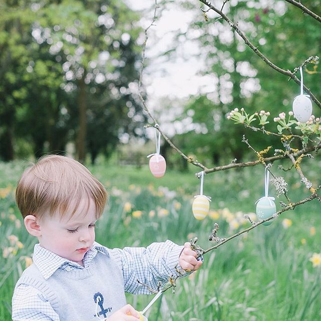 Hanging up Easter eggs on a little tree in the garden. 🐰🐥🌿 This morning we went to Farmer Gow's activity farm, where we got to hold chicks and ducklings (Edward was rather alarmed by this, even when someone else was doing the holding), as well as ride on toy tractors, climb on and underneath hay bales and feed lambs and amazingly bouncy goat kids. 🐰🐣🌿 We're now having a quiet coffee post-Easter egg hunt. Hope everyone is having a lovely afternoon. 🐰🐥🌿 #moc_036 #acupofmotherhood…