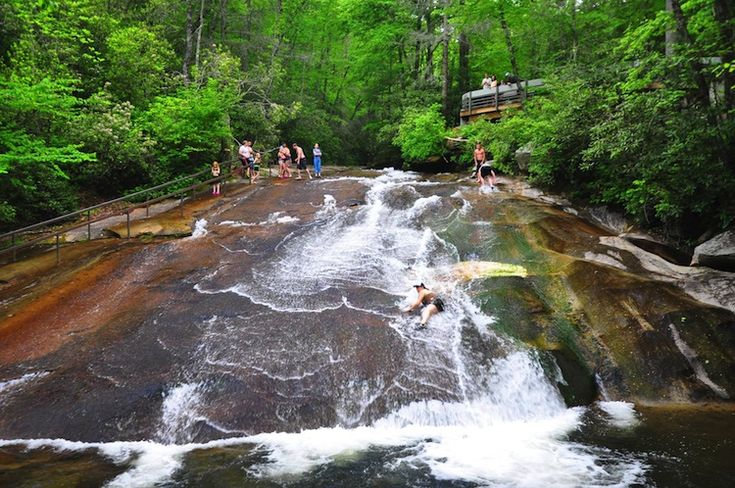Sliding Rock swimming hole in NC..Sliding Rock, North Carolina  This is a fantastic rock waterfall that is so smooth you can use it as a water slide. However, be warned, the water is very chilly. Though that's probably a welcome respite from the scorching summer sun. Recently, these North Carolina summers have been crazy hot. Thanks a lot, global warming!
