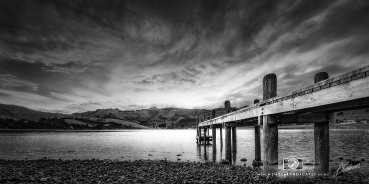 Black and white photo of a jetty at Duvauchelle, Banks Peninsula.