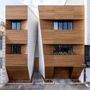 Afsharian's+House+by+ReNa+Design+has+a+huge+vertical+slice+in+its+facade
