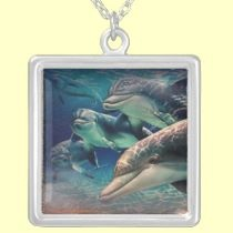 Happy Dolphin necklaces by seaskys