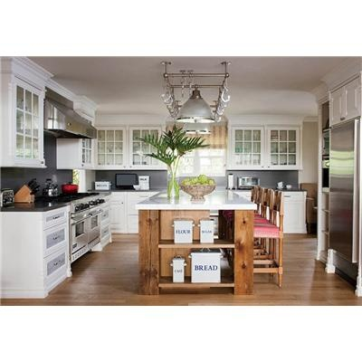 White cabinets and drawers with dark grey splashback, pale timbers - works well. GIANT island bench!