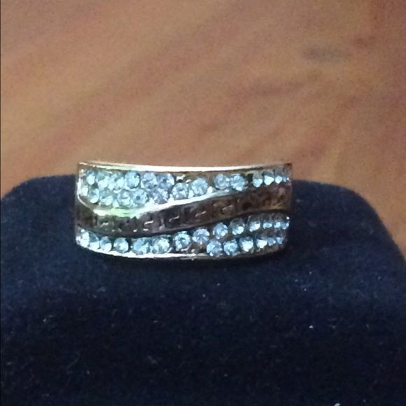 14K Rose Gold Plated CZ Ring. Size 8 Fashion ring with Greek key etching and rows of CZ (cubic zirconia) stones. Perfect for everyday wear or cocktails. Size 8. NWOT. If you have questions, please ask. Jewelry Rings