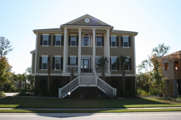 Stunning elevated home features southern porch with 2 for 2 story porch columns