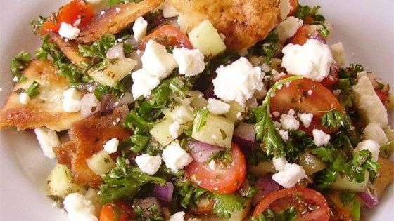 This Arabic fattoush salad is a colorful tossed salad with a lemony garlic dressing. (Serve over romaine like Le Kabob)