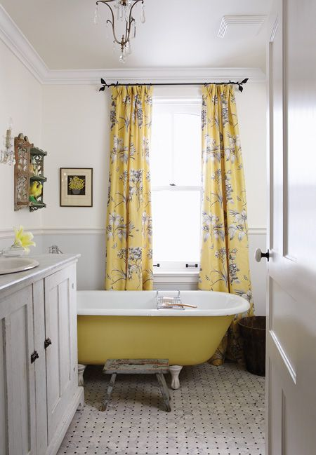 In her Collingwood country house, Sarah Richardson painted a salvaged clawfoot tub yellow to coordinate with the country-chic drapes. The vanity is also a reclaimed find that blends well with the feel